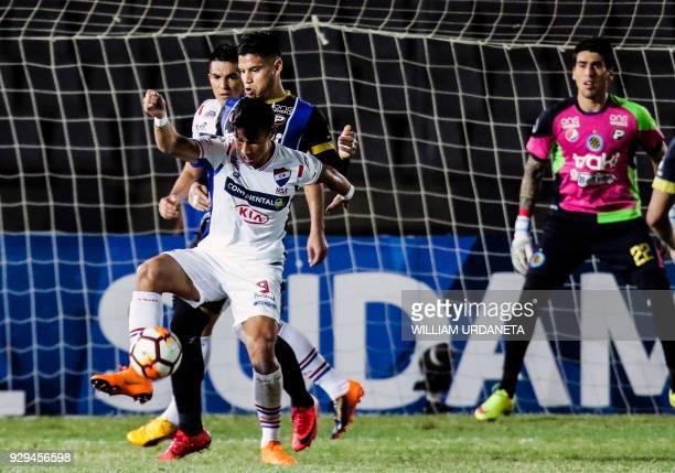 Adam Bareiro of Paraguay's Nacional vies for the ball with Francisco Flores of Venezuela's Mineros during their Copa Sudamericana 2018 football match...