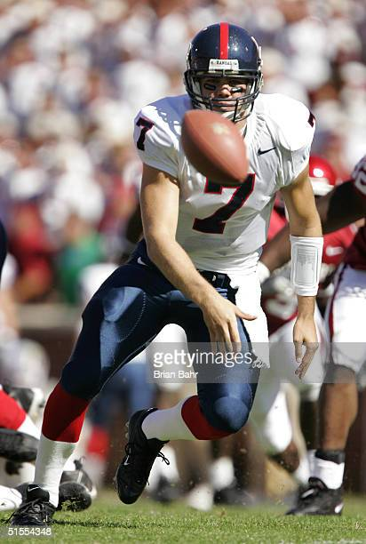 Adam Barmann of the Kansas Jayhawks pitches the ball out against the Oklahoma Sooners on October 23 2004 at Memorial Stadium in Norman Oklahoma The...
