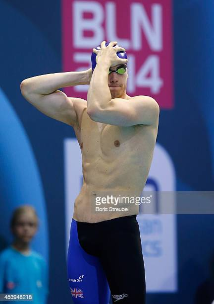 Adam Barrett of Great Britain looks on prior to the men's 100m butterfly heats during day 10 of the 32nd LEN European Swimming Championships 2014 at...