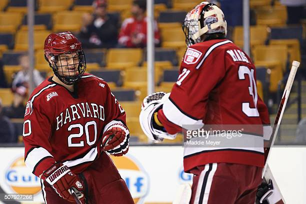 Adam Baughman of the Harvard Crimson celebrates with Merrick Madsen after scoring a goal against the Boston College Eagles during the first period at...