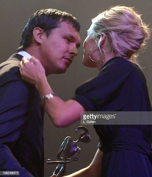 Adam Beach and Sienna Miller during 18th International Palm Springs Film Festival Awards Gala Inside at Palm Springs Convention Center in Palm...