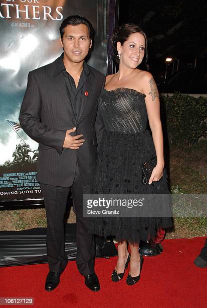 Adam Beach and Tara Mason during Flags of Our Fathers Los Angeles Premiere Arrivals at Academy Theatre in Beverly Hills California United States