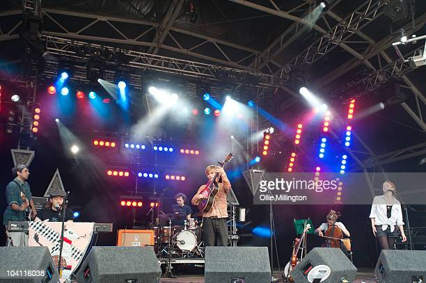 Adam Beach, David Beauchamp, Matt Edmonds, Johnny Flynn, Joe Zeitlin and Lillie Flynn of Johnny Flynn & the Sussex Wit performs on stage during the...