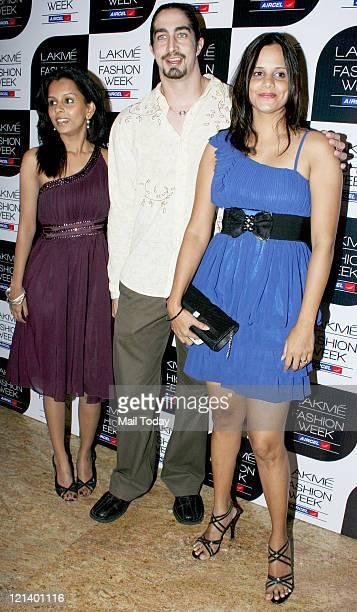Adam Bedi and Nisha Harale during Lakme Fashion Week winter/Festive 2011 being held at Grand Hyatt in Mumbai on Thursday