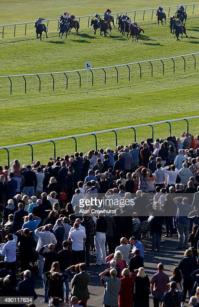 Adam Beschizza riding Third Time Lucky win The Betfred Cambridgeshire at Newmarket racecourse on September 26 2015 in Newmarket England