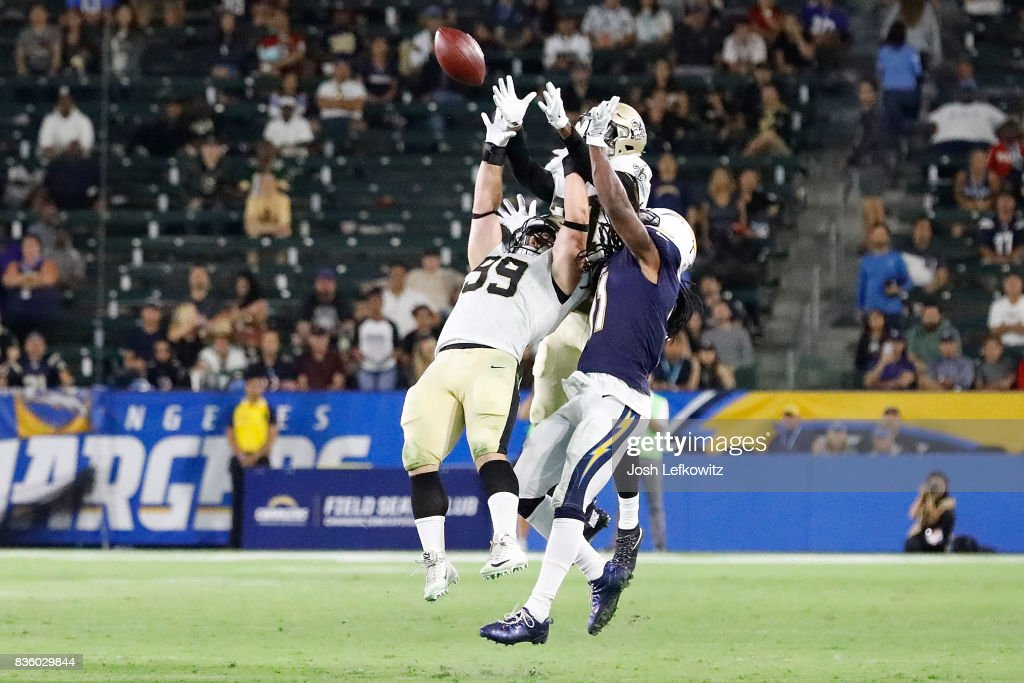 Adam Bighill #99 of the New Orleans Saints intercepts the ball after Cardale Jones #5 of the Los Angeles Chargers passes deep right intended for Geremy Davis #11 during the game between the Los Angeles Chargers and the New Orleans Saints at the StubHub Center on August 20, 2017 in Carson, California.