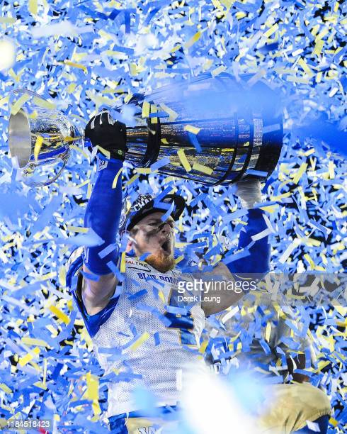 Adam Bighill of the Winnipeg Blue Bombers holds up the Grey Cup after defeating the Hamilton Tiger-Cats during the 107th Grey Cup Championship Game...