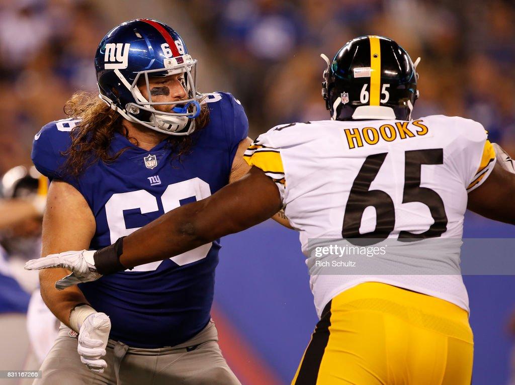 buy online 256d8 2d6b8 Adam Bisnowaty of the New York Giants blocks Lavon Hooks of ...