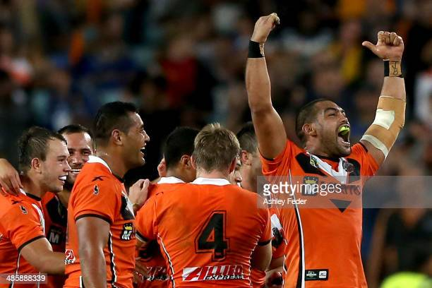 Adam Blair celebrates the win with his Wests Tigers teammates after winning during the round seven NRL match between the Parramatta Eels and the...