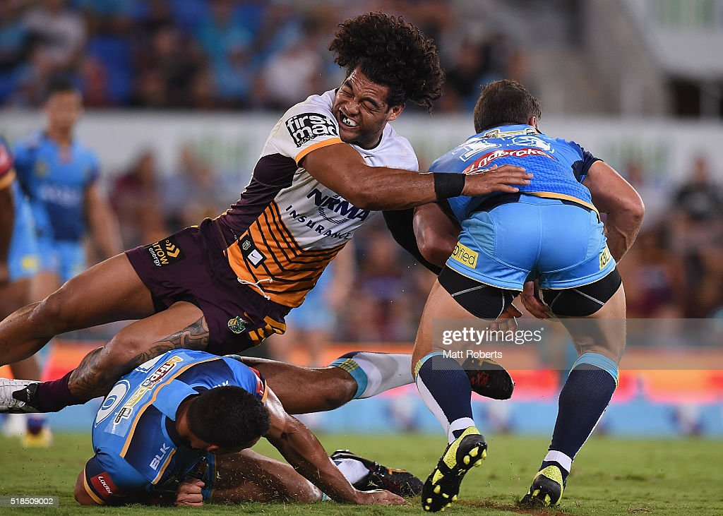 Adam Blair of the Broncos attempts to tackle Greg Bird of the Titans during the round five NRL match between the Gold Coast Titans and the Brisbane Broncos at Cbus Super Stadium on April 1, 2016 in Gold Coast, Australia.