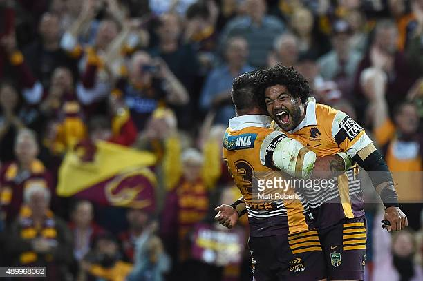 Adam Blair of the Broncos celebrates victory with Corey Parker during the NRL First Preliminary Final match between the Brisbane Broncos and the...