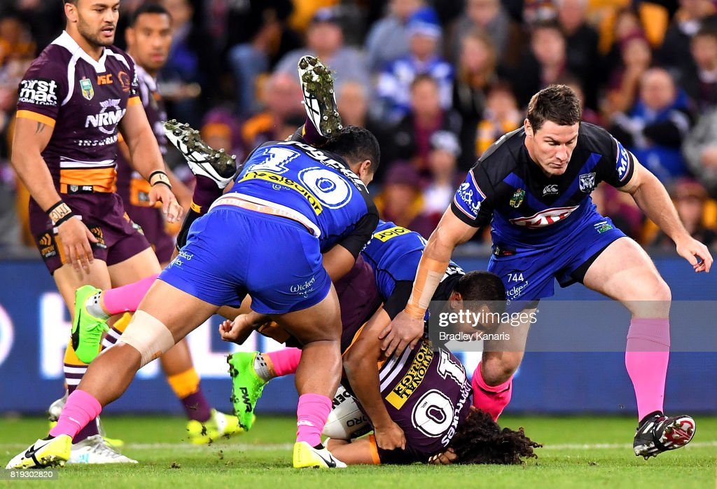 Adam Blair of the Broncos is lifted in the tackle by Danny Fualalo of the Bulldogs during the round 20 NRL match between the Brisbane Broncos and the Canterbury Bulldogs at Suncorp Stadium on July 20, 2017 in Brisbane, Australia.