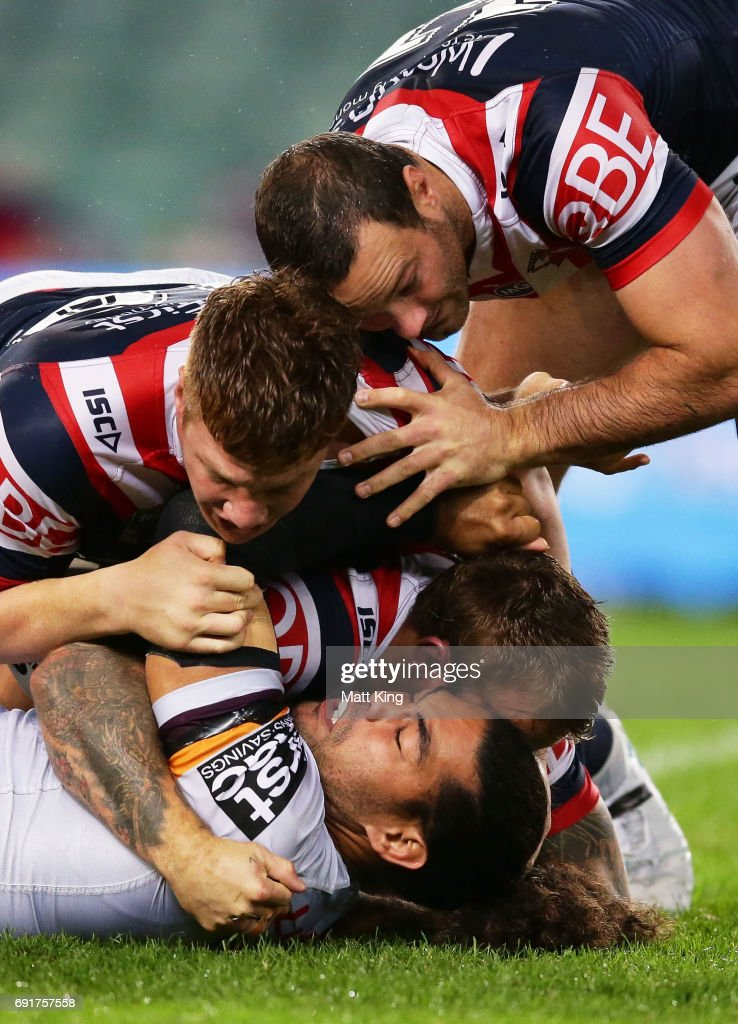 Adam Blair of the Broncos is tackled during the round 13 NRL match between the Sydney Roosters and the Brisbane Broncos at Allianz Stadium on June 3, 2017 in Sydney, Australia.