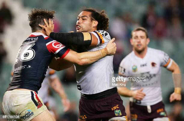 Adam Blair of the Broncos is tackled during the round 13 NRL match between the Sydney Roosters and the Brisbane Broncos at Allianz Stadium on June 3...