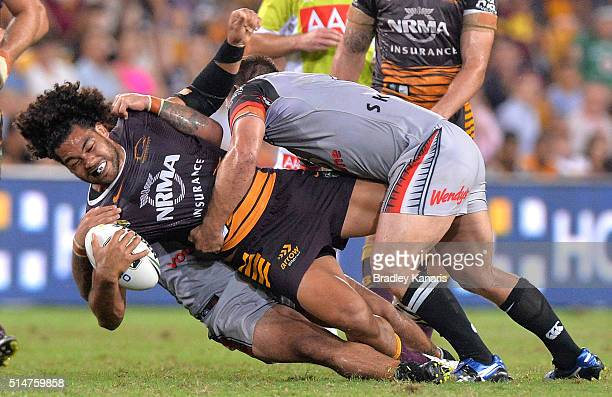 Adam Blair of the Broncos is tackled during the round two NRL match between the Brisbane Broncos and the New Zealand Warriors at Suncorp Stadium on...