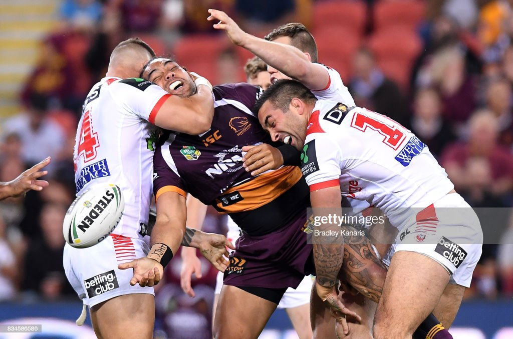 Adam Blair of the Broncos offloads during the round 24 NRL match between the Brisbane Broncos and the St George Illawarra Dragons at Suncorp Stadium on August 18, 2017 in Brisbane, Australia.