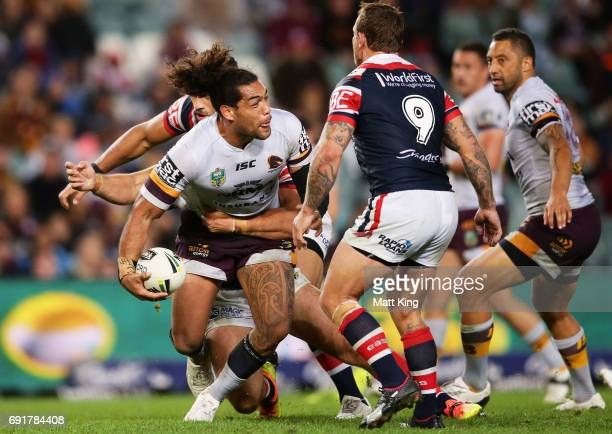Adam Blair of the Broncos offloads the ball in a tackle during the round 13 NRL match between the Sydney Roosters and the Brisbane Broncos at Allianz...