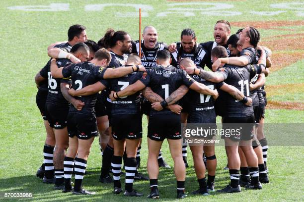 Adam Blair of the Kiwis and his team mates perform the Haka prior to the 2017 Rugby League World Cup match between the New Zealand Kiwis and Scotland...
