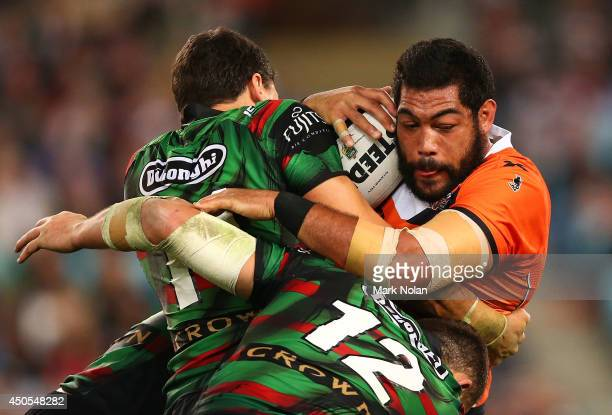Adam Blair of the Tigers is tackled during the round 14 NRL match between the South Sydney Rabbitohs and the Wests Tigers at ANZ Stadium on June 13,...