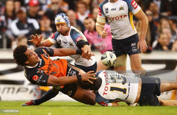 Adam Blair of the Tigers offloads during the round 12 NRL match between the Wests Tigers and the North Queensland Cowboys at Campbelltown Sports...