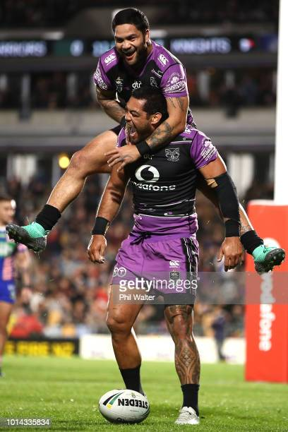Adam Blair of the Warriors is congratulated on his try and lept upon by Issac Luke during the round 22 NRL match between the New Zealand Warriors and...
