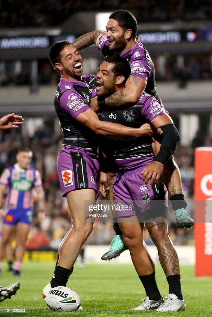 Adam Blair of the Warriors is congratulated on his try and lept upon by Issac Luke and Gerard Beale (L) during the round 22 NRL match between the New Zealand Warriors and the Newcastle Knights at Mt Smart Stadium on August 10, 2018 in Auckland, New Zealand.