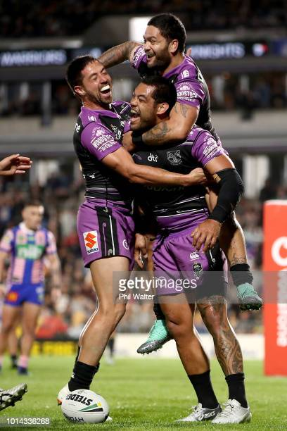 Adam Blair of the Warriors is congratulated on his try and lept upon by Issac Luke and Gerard Beale during the round 22 NRL match between the New...