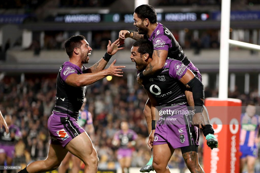 Adam Blair of the Warriors is congratulated on his try by Issac Luke and Gerard Beale (L) during the round 22 NRL match between the New Zealand Warriors and the Newcastle Knights at Mt Smart Stadium on August 10, 2018 in Auckland, New Zealand.