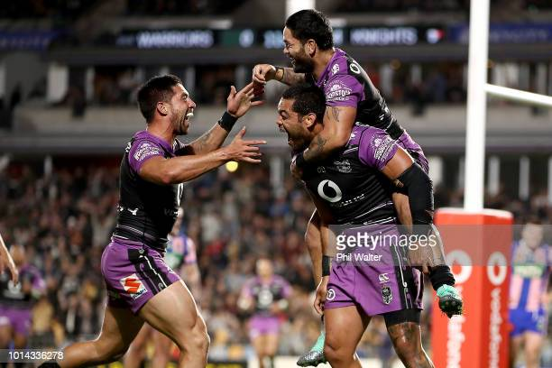 Adam Blair of the Warriors is congratulated on his try by Issac Luke and Gerard Beale during the round 22 NRL match between the New Zealand Warriors...