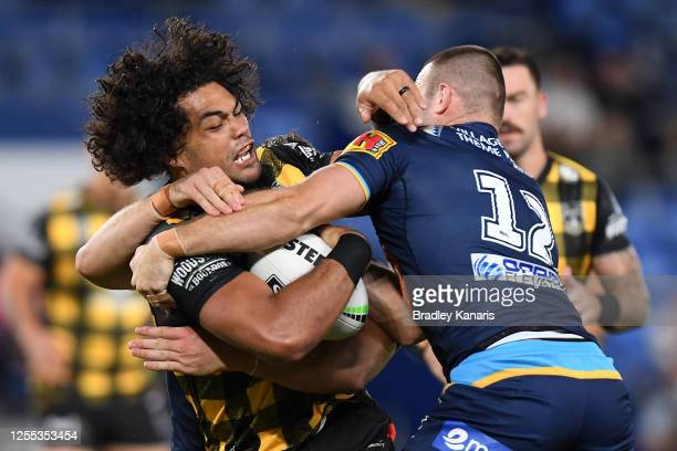 Adam Blair of the Warriors is tackled during the round nine NRL match between the Gold Coast Titans and the New Zealand Warriors at Cbus Super...