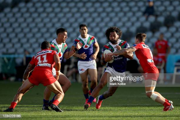 Adam Blair of the Warriors is tackled during the round three NRL match between the New Zealand Warriors and the St George Illawarra Dragons at...