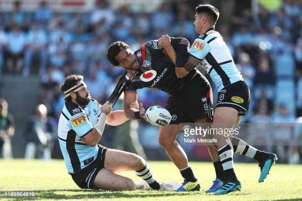 Adam Blair of the Warriors offloads during the round 23 NRL match between the Cronulla Sharks and the New Zealand Warriors at Shark Park on August...