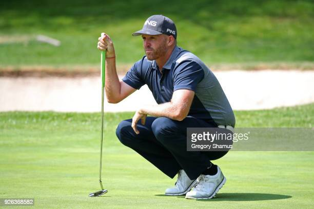 Adam Bland lines up a putt on the first green during the second round of World Golf ChampionshipsMexico Championship at Club de Golf Chapultepec on...