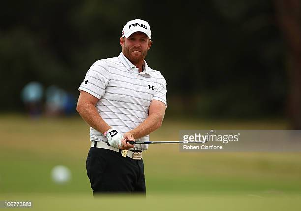 Adam Bland of Australia chips onto the 6th to birdie during round two of the Australian Masters at The Victoria Golf Club on November 12 2010 in...