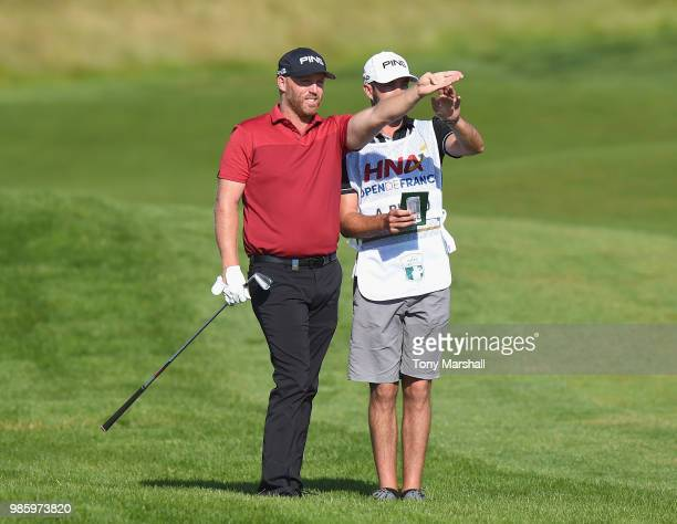 Adam Bland of Australia decides on the line of his second shot on the 10th fairway during Day One of the HNA Open de France at Le Golf National on...