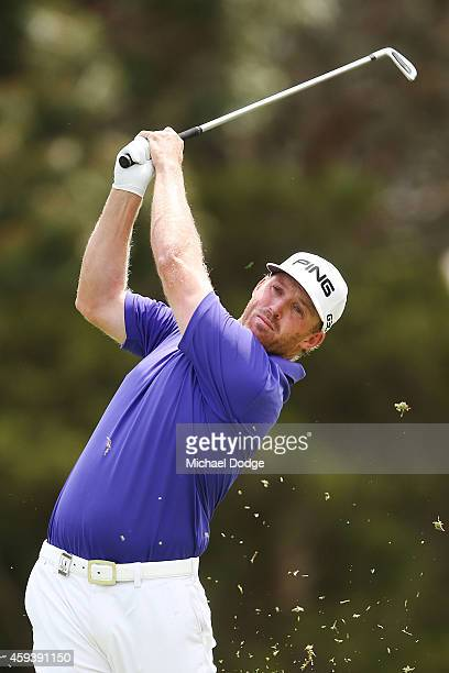 Adam Bland of Australia hits an approach on the 14th fairway during day three of the Australian Masters at The Metropolitan Golf Course on November...