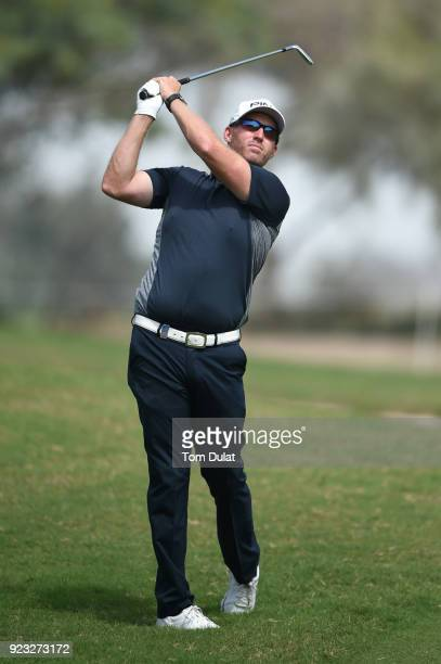 Adam Bland of Australia hits an approach shot during the second round of the Commercial Bank Qatar Masters at Doha Golf Club on February 23 2018 in...