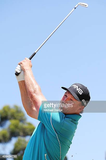 Adam Bland of Australia hits an approach shot on the 1st hole during day four of the Australian Masters at The Metropolitan Golf Course on November...