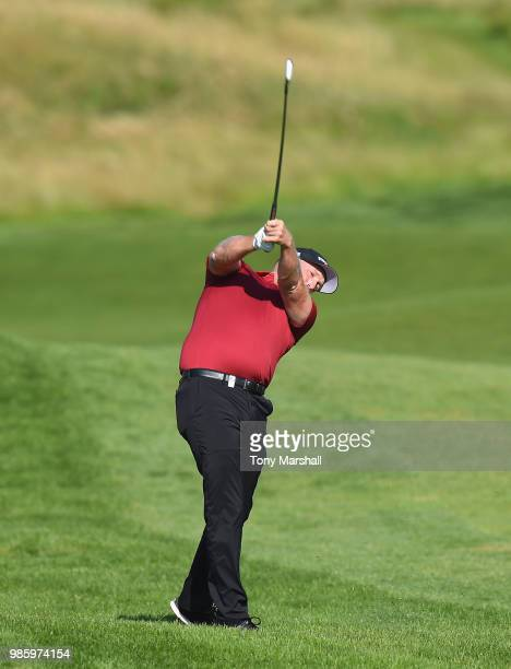 Adam Bland of Australia plays his second shot on the 10th fairway during Day One of the HNA Open de France at Le Golf National on June 28 2018 in...