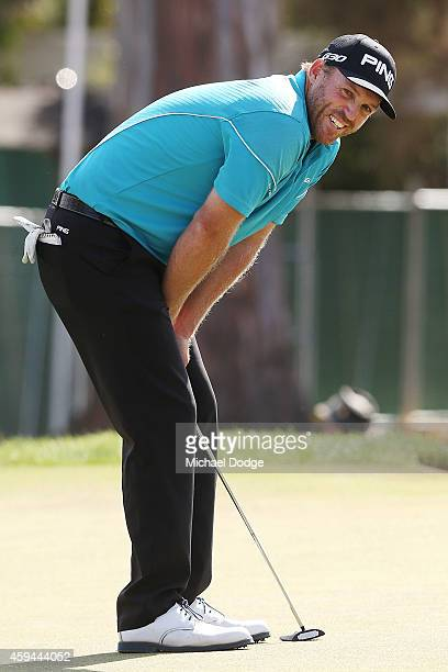 Adam Bland of Australia reacts after missing a putt on the 18th green during day four of the Australian Masters at The Metropolitan Golf Course on...