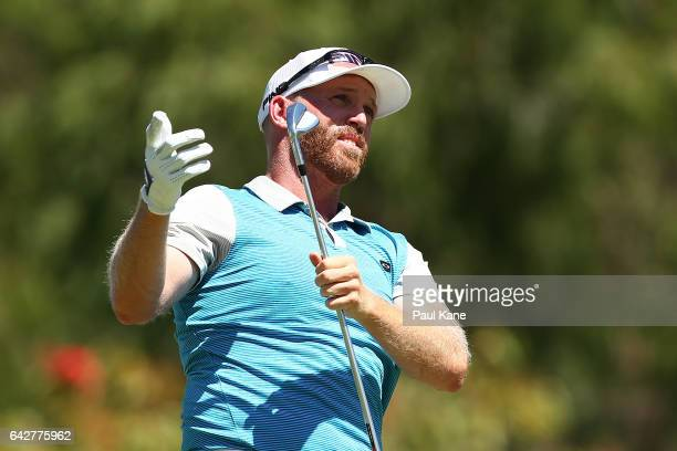 Adam Bland of Australia reacts to his tee shot on the 5th hole during match four of the match play during round four of the ISPS HANDA World Super 6...
