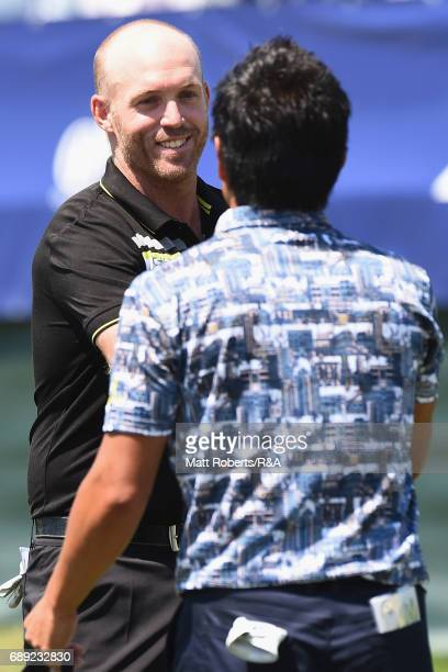 Adam Bland of Australia shakes hands with Katsumasa Miyamoto of Japan on the 18th green during the final round of Mizuno Open at JFE Setonaikai Golf...