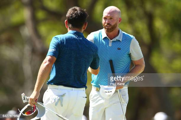 Adam Bland of Australia shakes hands with Louis Oosthuizen of South Africa after winning match eighteen of the match play during round four of the...