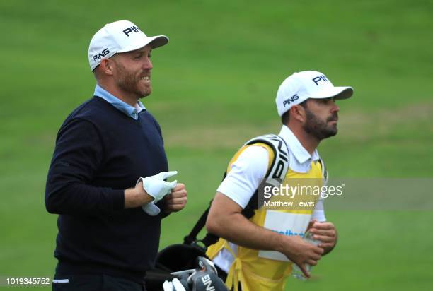 Adam Bland of Australia walks up the 14th fairway with his caddie during day four of the Nordea Masters at Hills Golf Club on August 19 2018 in...