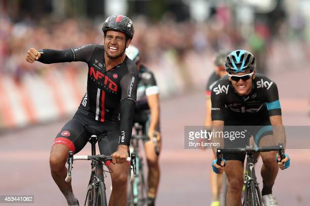 Adam Blyth of Great Britain and NFTO celebrates beating Ben Swift of Great Britain and Team SKY to win the Prudential RideLondonSurrey Classic from...