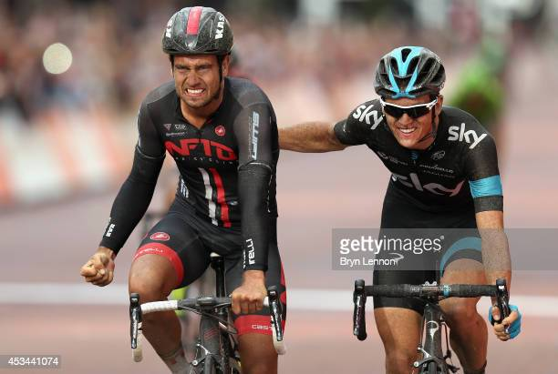 Adam Blyth of Great Britain and NFTO is congratulated by Ben Swift of Great Britain and Team SKY after winning the Prudential RideLondonSurrey...