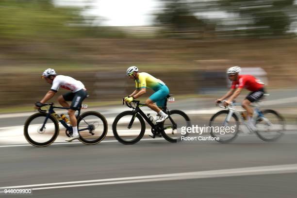 Adam Blythe of England Steele Von Hoff of Australia and Jonathan Mould of Wales compete during the Men's Road Race on day 10 of the Gold Coast 2018...