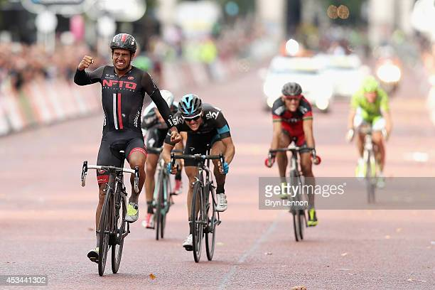 Adam Blythe of Great Britain and NFTO celebrates after winning the Prudential RideLondonSurrey Classic from the Queen Elizabeth Olympic Park to The...
