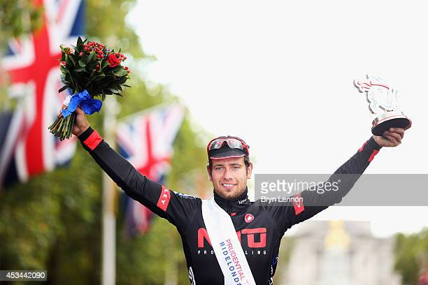 Adam Blythe of Great Britain and NFTO celebrates winning the Prudential RideLondonSurrey Classic from the Queen Elizabeth Olympic Park to The Mall on...