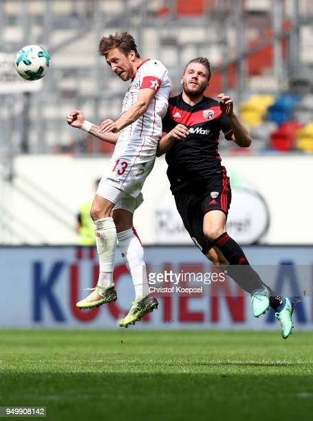 Adam Bodzek of Duesseldorf and Robert Leipertz of Ingolstadt go up for a header during the Second Bundesliga match between Fortuna Duesseldorf and FC...